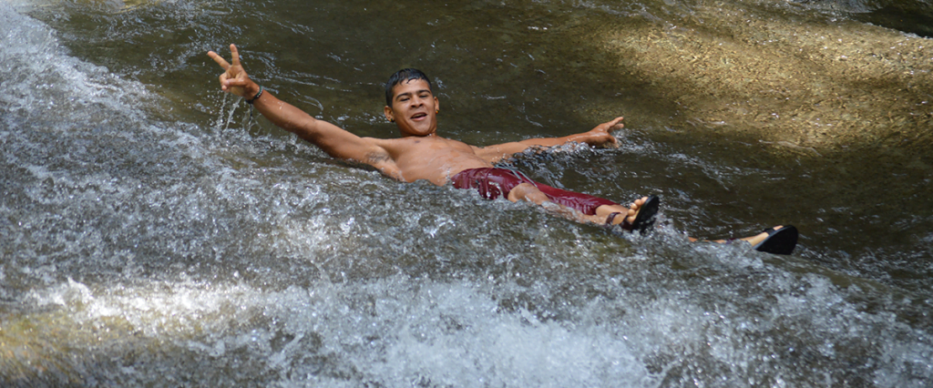 Man in natural waterslide